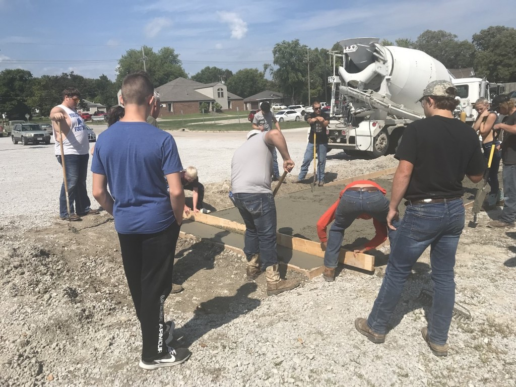 Construction class pouring concrete