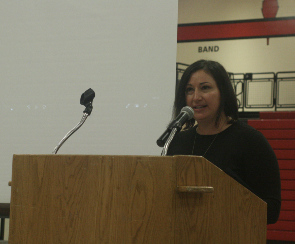 Megan Kallina prepared a slide show of area service men and women and spoke to students about the dedication of the elite 1% who raise their right hand to serve the country.