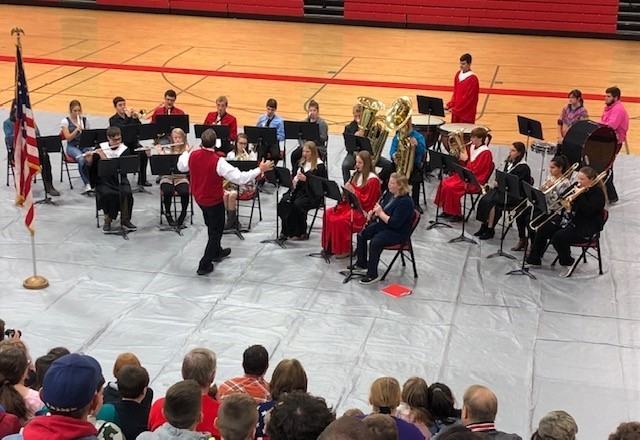 "The band and choir performed a joint rendition of ""America the Beautiful"" as part of today's program.  Members of the band also played ""Taps"" to close out the ceremony."